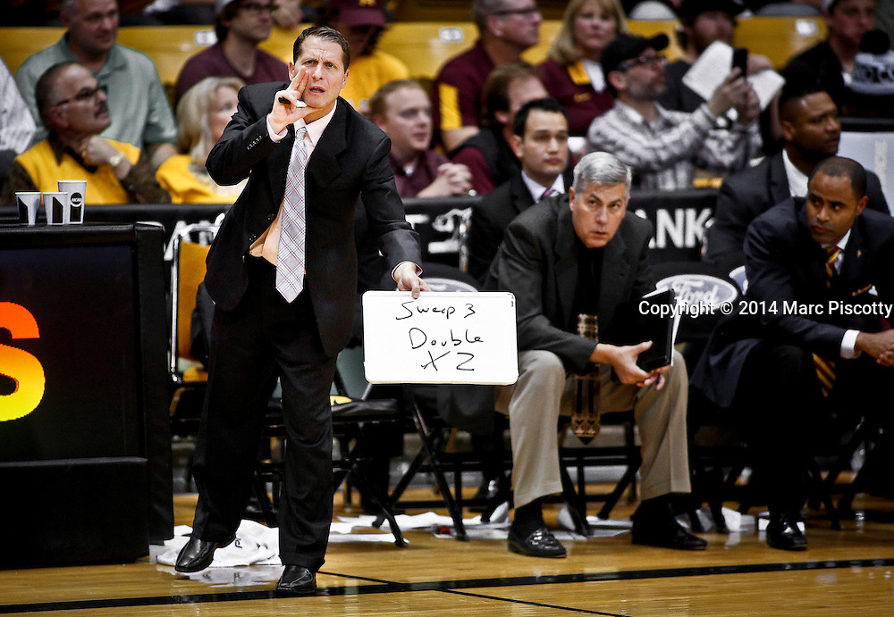 SHOT 2/19/14 11:13:41 PM - Arizona State Associate Head Coach Eric Musselman calls out a play to his team during their regular season Pac-12 basketball game against Colorado at the Coors Events Center in Boulder, Co. Colorado won the game 61-52.<br /> (Photo by Marc Piscotty / &copy; 2014)