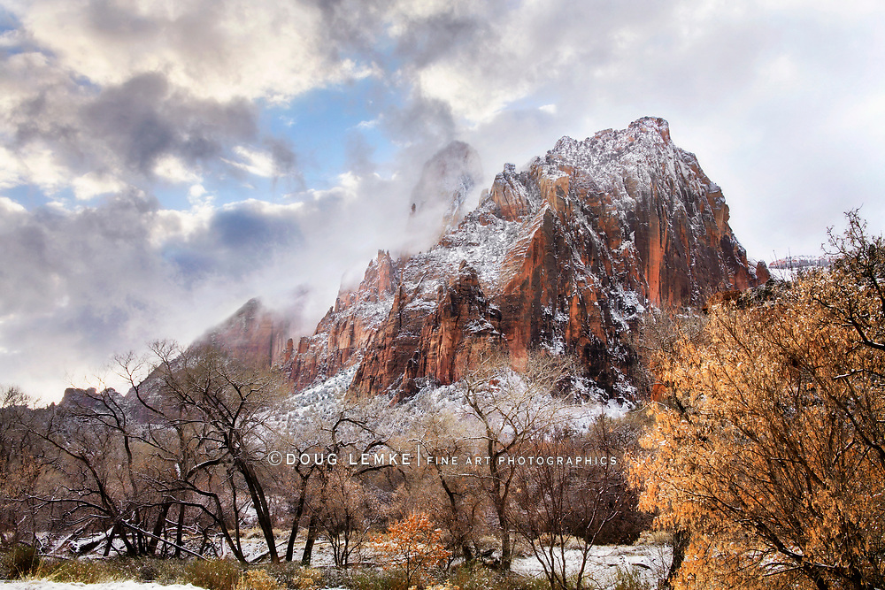 A Craggy Mountain Peak And Winter Snow Over The Virgin River On A Stormy Day At Zion National Park, Utah, USA