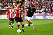 Pierce Sweeney (2) of Exeter City battles for possession with Ollie Palmer (8) of Lincoln City during the EFL Sky Bet League 2 match between Exeter City and Lincoln City at St James' Park, Exeter, England on 19 August 2017. Photo by Graham Hunt.