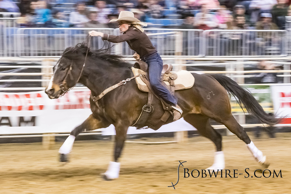 Nicole Fritz makes her barrel run at the Bismarck Rodeo on Friday, Feb. 2, 2018. She ran a 13.42.