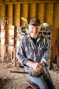 Portrait of Bob Denman in his forge in Boring, Oregon