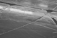 10 April 2009: Black and White photo of puddles of water in cracks on the ice in Anaheim, CA.