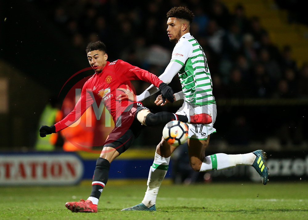 Jesse Lingard of Manchester United is tackled by Omar Sowunmi of Yeovil Town- Rogan/JMP - 26/01/2018 - FOOTBALL - Huish Park - Yeovil, England - Yeovil Town v Manchester United - FA Cup Fourth Round.
