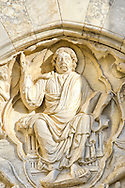 Christ in Glory is sculpted on the portal over the entrance to the Cathedral of Maguelone, in Villeneuve-lès-Maguelone, on the Mediterranean coast near Montpellier . The symbolism of the portal as the gate of heaven and the fountain of life.