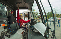 Kadein Moore lets everyone know he's in the drivers seat during the Explore A Truck day event at Laconia Dept of Public Works Saturday morning.  (Karen Bobotas/for the Laconia Daily Sun)