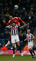 Photo: Steve Bond/Sportsbeat Images.<br /> West Bromwich Albion v Charlton Athletic. Coca Cola Championship. 15/12/2007. Madjid Bougherra wins a header above Jonathan Greening