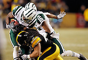New York Jets wide receiver Jerricho Cotchery (89) takes a wicked hit by Pittsburgh Steelers safety Troy Polamalu (43) during the fourth quarter of the NFL 2011 AFC Championship playoff football game against the Pittsburgh Steelers on Sunday, January 23, 2011 in Pittsburgh, Pennsylvania. The Steelers won the game 24-19. (©Paul Anthony Spinelli)