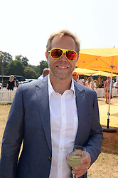 SEBASTIAN PEARSON at the Veuve Clicquot Gold Cup, Cowdray Park, Midhurst, West Sussex on 21st July 2013.
