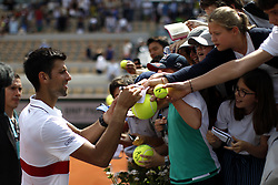 May 30, 2018 - Paris, Ile-de-France, France - Novak Djokovic of Serbia sign his ball during the second round at Roland Garros Grand Slam Tournament - Day 4 on May 30, 2018 in Paris, France. (Credit Image: © Mehdi Taamallah/NurPhoto via ZUMA Press)