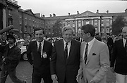 Nissan International Cycle Race..1986..01.10.1986..10.01.1986..1st October 1986..The Nissan Classic began today from Trinity College,Dublin. The offical race starter was The Taoiseach,Dr Garrett FitzGerald TD. He was accompanied by the Minister for Sport,Mr Sean Barrett TD..Sean Kelly was returning to defend his title but his opposition included Greg LeMond, the 1983 world champion and the winner of the Tour de France of the previous July. Roche was out due to his injured leg. Adri van der Poel was back with 1980 Tour de France winner and 1985 world champion Joop Zoetemelk. Teun van Vliet was back too. The winner of the green jersey of the Tour de France that July, Eric Vanderaerden was there as well as Australians Phil Anderson and Alan Peiper as well the Scottish cyclist Robert Millar...Picture shows,An Taoiseach,Dr Garrett FitzGerald arriving in Trinity College to officially start the race.