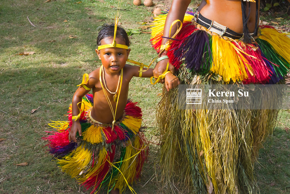 Yapese woman in traditional clothing with little girl at Yap Day Festival, Yap Island, Federated States of Micronesia
