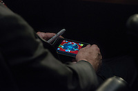 WASHINGTON, DC - SEPTEMBER 3:  Senator John McCain plays poker on his IPhone during a U.S. Senate Committee on Foreign Relations hearing where Secretary of State John Kerry, Secretary of Defense Chuck Hagel, and Chairman of the Joint Chiefs of Staff General Martin Dempsey testify concerning the use of force in Syria, on  Capitol Hill in Washington DC, Tuesday, September 3, 2013. (Photo by Melina Mara/The Washington Post)
