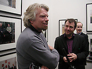 Sir Richard Branson and  ( work partner) Will whitehorn. Managing Partners exhibition.  Photos by Jillian Edelstein, Tom Miller and Dudley Reed . National Portrait Gallery.  5 March 2001. © Copyright Photograph by Dafydd Jones 66 Stockwell Park Rd. London SW9 0DA Tel 020 7733 0108 www.dafjones.com