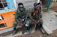 Nyabiondo. D.R.C.  FDLR rebel soldiers, members of the Col. Sadiki Soleil's body guards, take a rest outside a little unamed hotel in the main and only  street in this town. (Photo by Miguel Juárez Lugo)