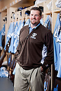 09/28/2012 - Medford, Mass. - Tufts head football coach Jay Civetti poses for a portrait in the team's locker room on Sept. 28, 2012. (Kelvin Ma/Tufts University)