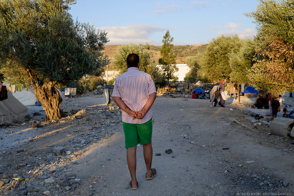 Refugee whose arms are marked for identification, walking in refugee camp Kara Tepe near Mytilene city. It hosts Syrian refugees who are waiting for their registration papers that will allow them to stay in Greece for some time till they can move to an other European country.