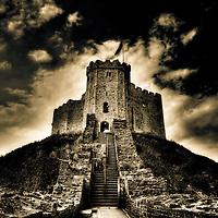 Dramatic shot of steps leading up to Cardiff Castle with dark skies