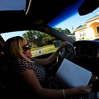 TAMPA, FL -- March 22, 2011 -- Shannon Moore, broker/owner of Green Lion Realty, talks with her investors as she drives through neighborhoods full of foreclosed upon homes in North Port, Fla., 2011.  A recent study showed that one and five homes in the state of Florida is vacant.