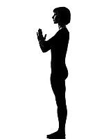 woman sun salutation yoga surya namaskar posture position in silouhette on studio white background full length