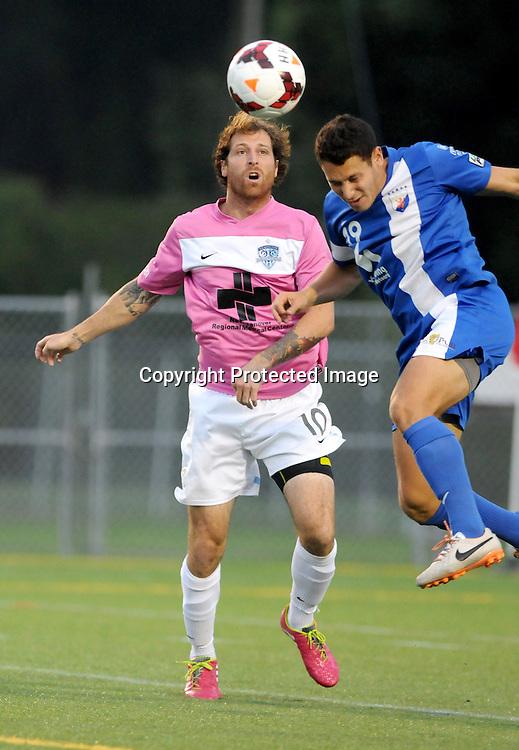 Wilmington's Cody Arnoux challenges Dayton's Ross Friedman Saturday August 9, 2014 at Legion Stadium in Wilmington, N.C. (Jason A. Frizzelle)