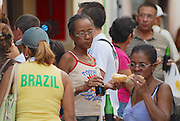 HAVANA, CUBA - OCTOBER 21, 2006: Unidentified people eat local street fast food in Havana, Cuba.