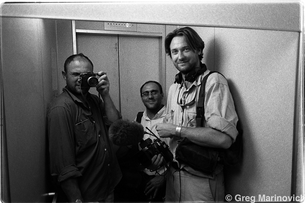 The team (Greg, Joao Silva, Dominc Cunningham-Reid) in an elevater that often stuck in Dushanbe, Tajikistan. (Greg Marinovich)