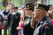Middletown, New York - A veteran salutes at Thrall Park during the Middletown-Town of Wallkill Memorial Day ceremonies on  May 25, 2015.