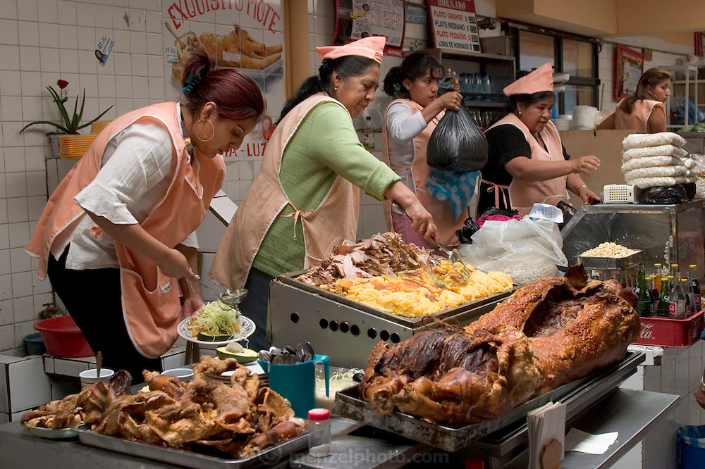 Several of the stalls in the Santa Carolina Market in Quito, Ecuador, specialize in roasted pig. (Supporting image from the project Hungry Planet: What the World Eats.)