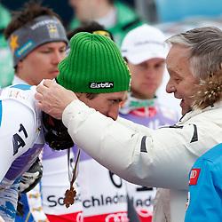 17.02.2013, Planai, Schladming, AUT, FIS Weltmeisterschaften Ski Alpin, Slalom,  Herren, Siegerpraesentation, im Bild Marcel Hirscher (AUT, 1. Platz) und Gian-Franco Kasper, FIS // 1st place Marcel Hirscher of Austria with Gian-Franco Kasper, FIS, on Winners Presentation during Mens Slalom at the FIS Ski World Championships 2013 at the Planai Course, Schladming, Austria on 2013/02/17. EXPA Pictures © 2013, PhotoCredit: EXPA/ Martin Huber