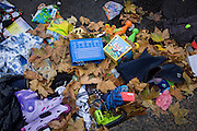 Charity shop donations strewn in the gutter outside a local thrifty shop in south London.