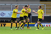 Celebrations as Burton Albion midfielder Callum Reilly (17) scores the openig goal during the EFL Cup match between Burton Albion and Bury at the Pirelli Stadium, Burton upon Trent, England on 10 August 2016. Photo by Aaron  Lupton.