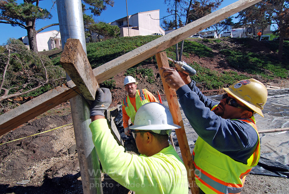 Bracing the support pole for the first basketball hoop after concrete has been poured around it on November 12th, 2015 at the Acosta Plaza Recreation Area in east Salinas, CA.