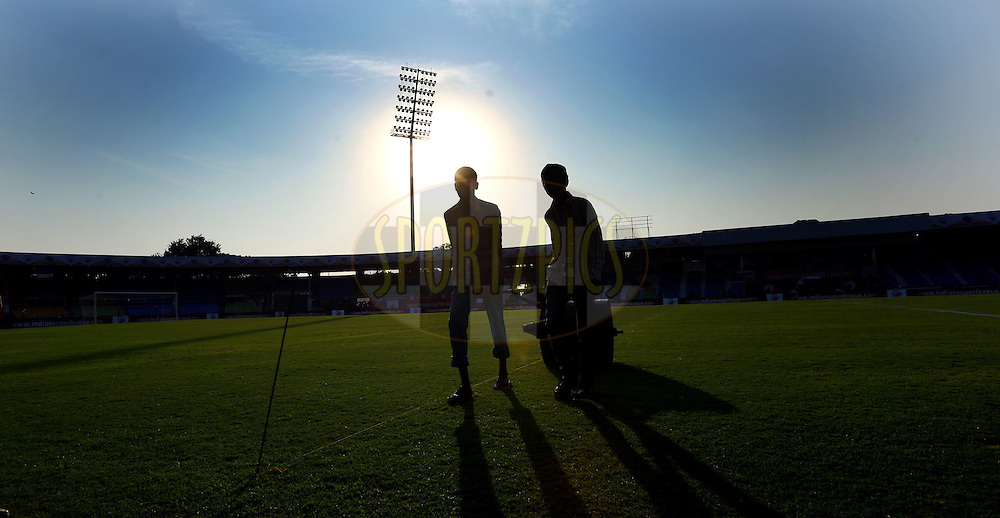 Ground staff working before the start of the match 48 of the Hero Indian Super League between FC Pune City and Mumbai City FC held at the Shree Shiv Chhatrapati Sports Complex Stadium, Pune, India on the 3rd December 2014.<br /> <br /> Photo by:  Sandeep Shetty/ ISL/ SPORTZPICS