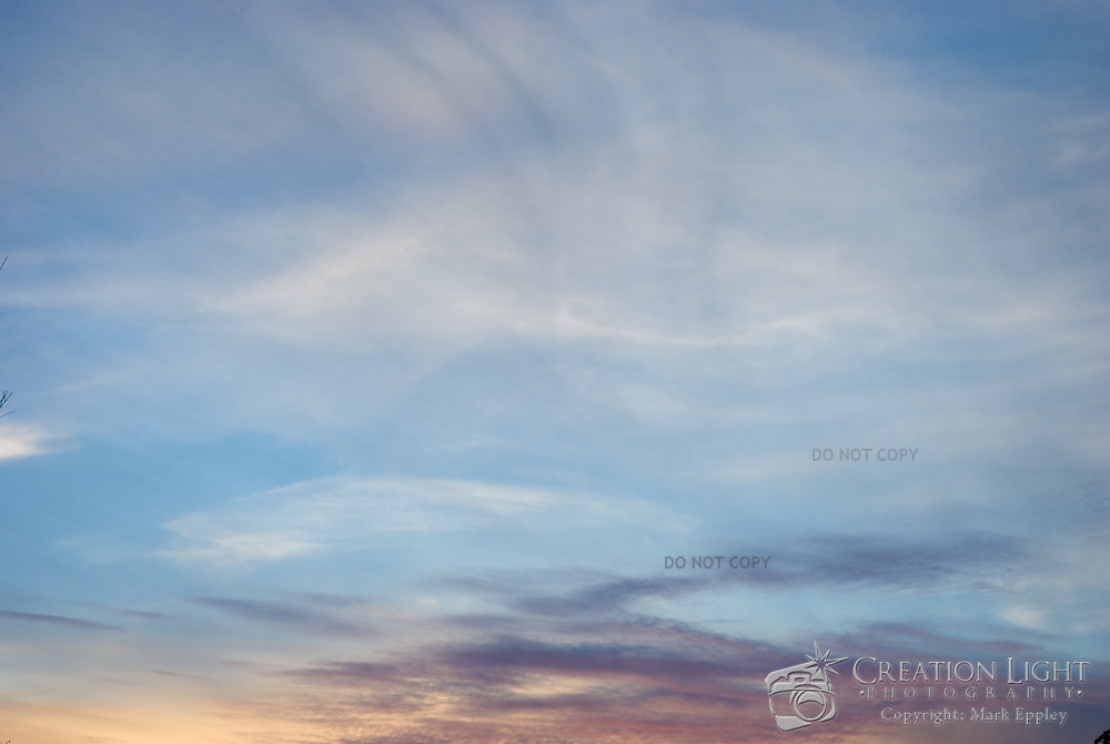 Purple color illuminates the sky at sunset.