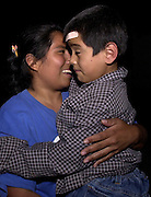 Alvina Villa Zarco, 25, (left), reacts after locating her son at Albergue Menor Repatriado, a shelter in Nogales, Sonora, Mexico, for children deported from the U.S. after they entered the country illegally.
