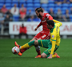 Norwich's Kyle Lafferty tackles Cardiff City's John Brayford - Photo mandatory by-line: Alex James/JMP - Mobile: 07966 386802 30/08/2014 - SPORT - FOOTBALL - Cardiff - Cardiff City stadium - Cardiff City  v Norwich City - Barclays Premier League