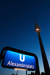 Dusk view of Television Tower and subway station sign at Alexanderplatz in central Berlin Germany 2009