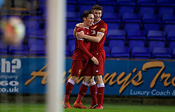 BIRKENHEAD, ENGLAND - Tuesday, December 19, 2017: Liverpool's Harry Wilson celebrates scoring the second goal with team-mate Matthew Virtue during the Under-23 FA Premier League International Cup Group A match between Liverpool and PSV Eindhoven at Prenton Park. (Pic by David Rawcliffe/Propaganda)