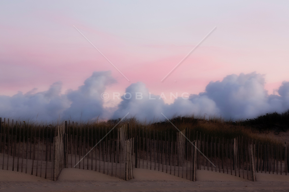 fence and clouds by a sand dune in Amagansett, NY