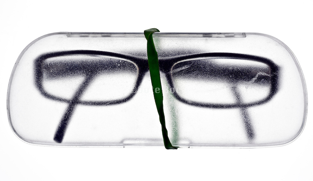 glasses in a protective transparent plastic carry case held close with a rubber string