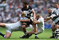 Chris Vui of the Barbarians is tackled by Ross Harrison and Tom Dunn of the England XV - Mandatory byline: Patrick Khachfe/JMP - 07966 386802 - 02/06/2019 - RUGBY UNION - Twickenham Stadium - London, England - England XV v Barbarians - Quilter Cup International