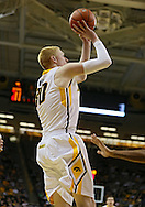February 27 2013: Iowa Hawkeyes forward Aaron White (30) puts up a shot during the first half of the NCAA basketball game between the Purdue Boilermakers and the Iowa Hawkeyes at Carver-Hawkeye Arena in Iowa City, Iowa on Wednesday, February 27 2013.