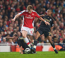 LONDON, ENGLAND - Wednesday, October 28, 2009: Liverpool's David Ngog and Arsenal's Nicklas Bendtner during the League Cup 4th Round match at Emirates Stadium. (Photo by David Rawcliffe/Propaganda)