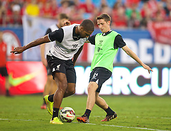 CHARLOTTE, USA - Friday, August 1, 2014: Liverpool's Joe Allen and Glen Johnson during a training session at the Bank of America Stadium on day twelve of the club's USA Tour. (Pic by David Rawcliffe/Propaganda)