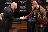 LAS VEGAS, NEVADA, JULY 9, 2009: UFC welterweight champion Georges St. Pierre (left) shakes hands with challenger Thiago Alves during the pre-fight press conference for UFC 100 inside the House of Blues in Las Vegas, Nevada