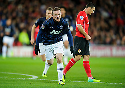 Man Utd Forward Wayne Rooney (ENG) celebrates scoring a goal during the first half of the match - Photo mandatory by-line: Rogan Thomson/JMP - Tel: Mobile: 07966 386802 - 24/11/2013 - SPORT - FOOTBALL - Cardiff City Stadium - Cardiff City v Manchester United - Barclays Premier League.