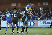 Darius Charles of Wimbledon heads at goal during the Sky Bet League 2 match between AFC Wimbledon and Portsmouth at the Cherry Red Records Stadium, Kingston, England on 26 April 2016.