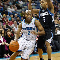 February 7, 2011; New Orleans, LA, USA; New Orleans Hornets point guard Jarrett Jack (2) drives past Minnesota Timberwolves point guard Sebastian Telfair (3) during the second quarter at the New Orleans Arena.   Mandatory Credit: Derick E. Hingle
