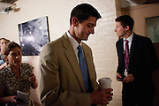 Rep. PAUL RYAN (R-WI) is trailed by reporters as he leaves a House Conference meeting at the U.S. Capitol on Wednesday as they continue negotiations on raising the debt ceiling.