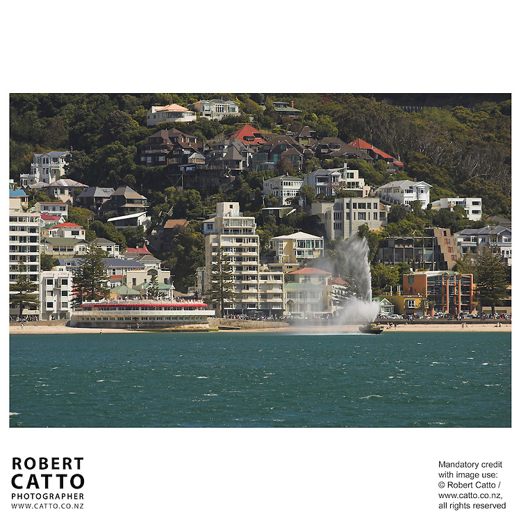 Oriental Bay beach with band rotunda and fountain seen from Lambton Harbour, Wellington, New Zealand.<br />
